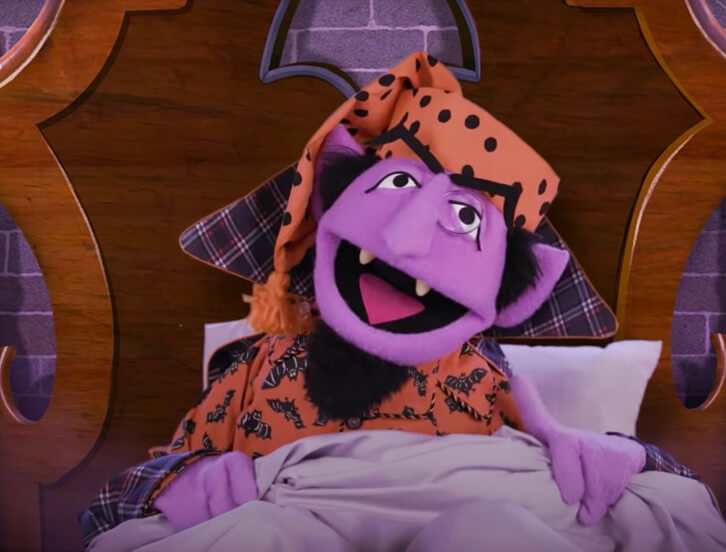 The Count wearing pajamas