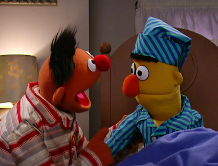 Bert and Ernie in pajamas