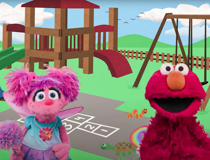 Abby and Elmo at a playground