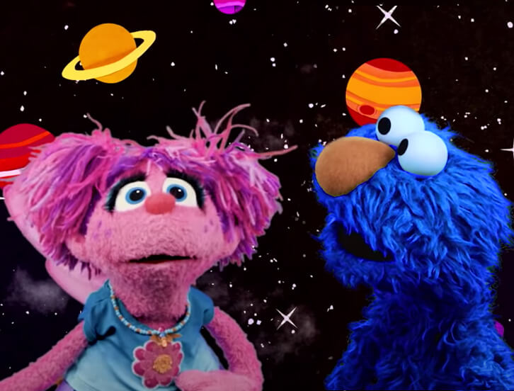 Abby and blue Elmo in space