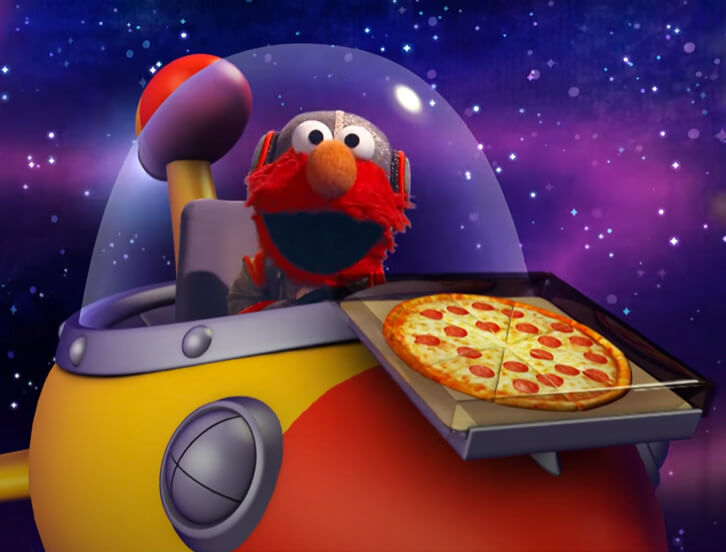 Elmo in space with a box of pizza