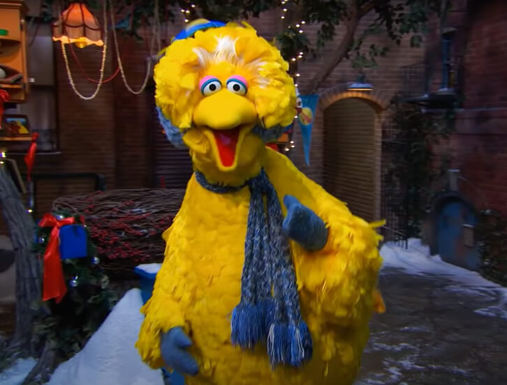 Big Bird singing about the holiday season