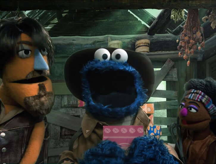 Cookie Monster and the walking gingerbread characters