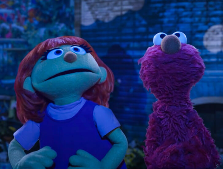 Julia and Elmo looking up to night sky